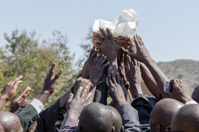 Hdi reach toward the Deftera Lfida Dzratawi as they pray at its dedication