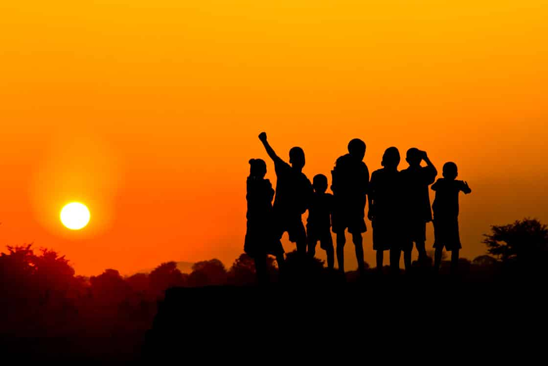 Sunset with group of people silhouetted